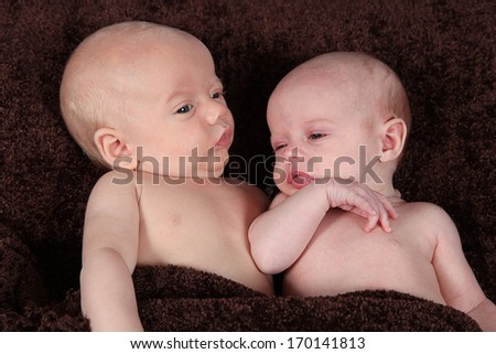 Adorable little brother and Sister twins on studio background - stock photo