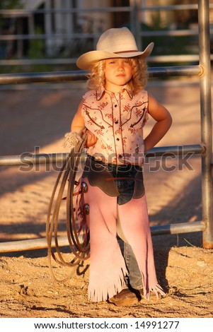 Adorable little cowgirl. - stock photo