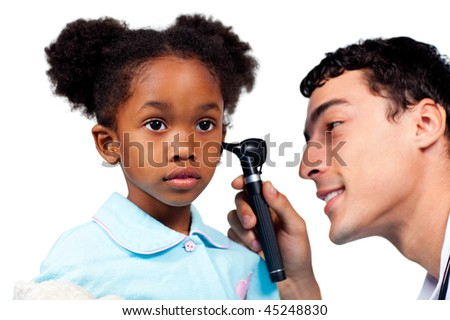 Adorable little girl at a medical visit isolated on a white background - stock photo