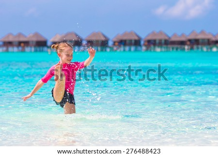 Adorable little girl at beach during summer vacation - stock photo