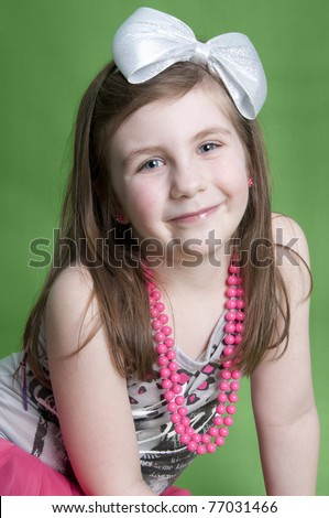 Adorable little girl dressed up in 80's clothes - stock photo