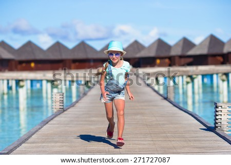 Adorable little girl during beach vacation having fun - stock photo