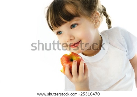 adorable little girl eating an apple, isolated against white background - stock photo