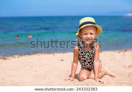 Adorable little girl have fun at tropical beach - stock photo
