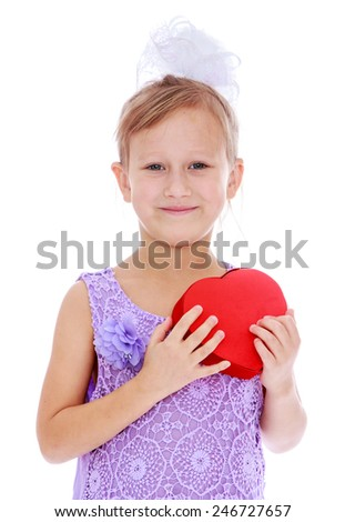 Adorable little girl holding a box on his chest in the form of heart.concept childhood education and child development.Isolated on white background - stock photo