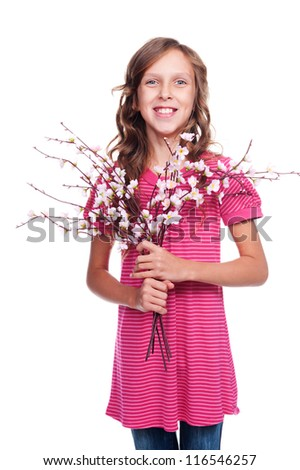 adorable little girl holding spring flowers and smiling. studio shot over white background - stock photo
