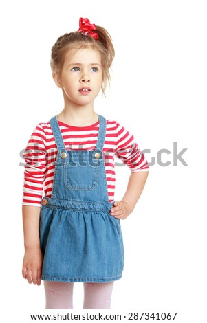 Adorable little girl in a striped shirt and a blue denim skirt , close-up-isolated on white background - stock photo