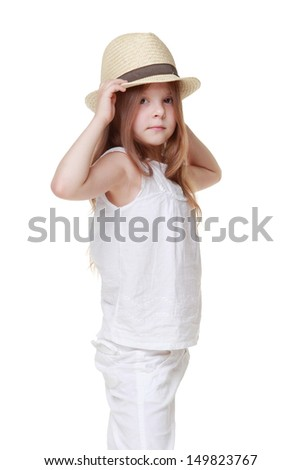 Adorable little girl in a summer dress and a hat on Beauty and Fashion - stock photo