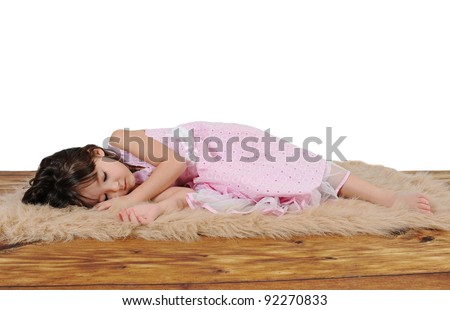 adorable little girl in dress asleep on furry brown rug. over white - stock photo