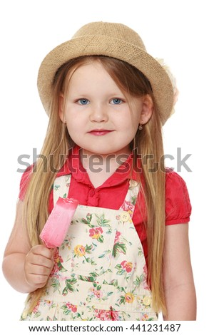 Adorable little girl in hat and pants, holds up the ice cream. Close-up-Isolated on white background - stock photo