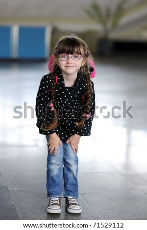 Adorable little girl in the airport - stock photo