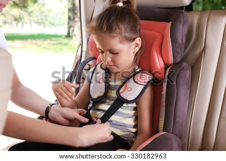 Adorable little girl in the car - stock photo