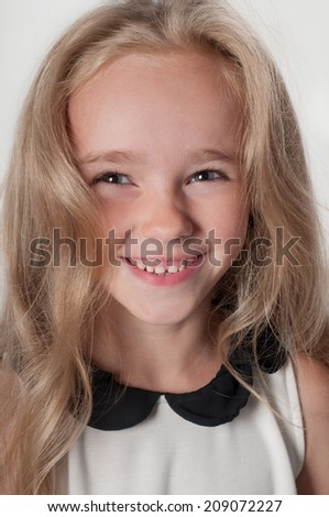 Adorable little girl in white - stock photo