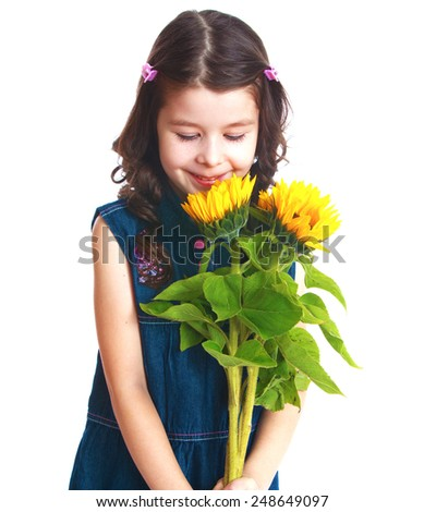 Adorable little girl is smelling flowers.Isolated on white background, Lotus Children's Center - stock photo