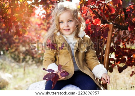 Adorable little girl is wearing winter clothes - stock photo