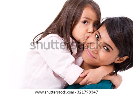 adorable little girl kissing her mother's cheek - stock photo