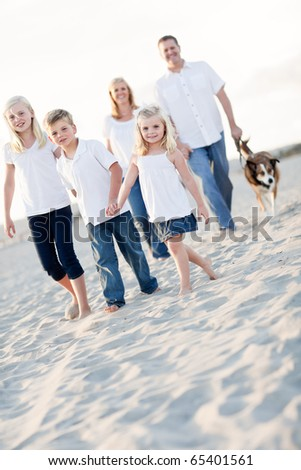 Adorable Little Girl Leads Her Family on a Walk at the Beach. - stock photo