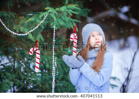 Adorable little girl on Christmas in winter day - stock photo
