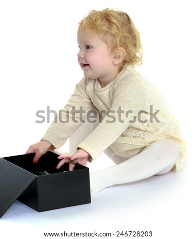 Adorable little girl opened the big black box.concept childhood education and child development.Isolated on white background - stock photo