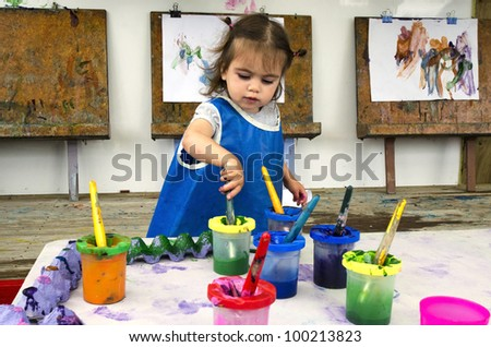 Adorable little girl painting and drawing.Concept photo of art, artwork, creativity and imagination. - stock photo
