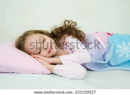 Adorable little girl sleeping in her bed.  Nighty night! good night! - stock photo