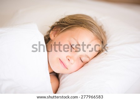 Adorable little girl sleeping in the bed - stock photo
