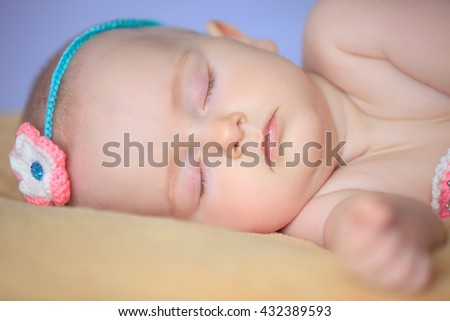 Adorable little girl slipping in her bed . Close-up - stock photo