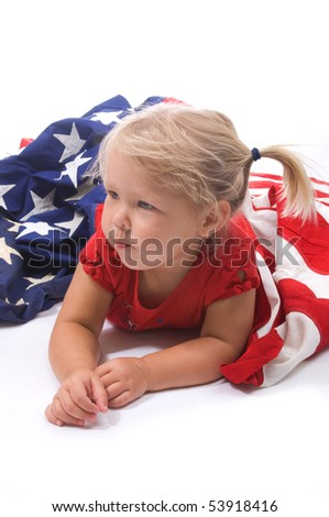 Adorable little girl with blond pigtails with an American flag - stock photo