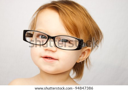 Adorable little girl with large glasses - stock photo