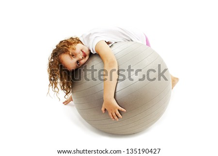 Adorable little girl with pilates ball. Isolated on white background - stock photo