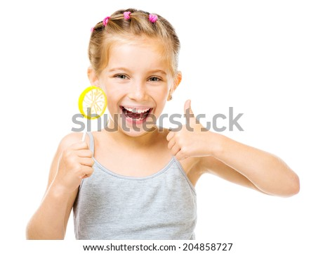 Adorable little girl with yellow lemon lollipop isolated over white background - stock photo