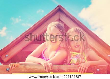 Adorable little girls outdoors in Summer - instagram effect - stock photo