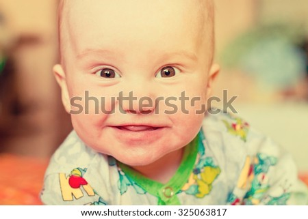 Adorable newborn baby boy smiling portrait. Image with vintage filter - stock photo