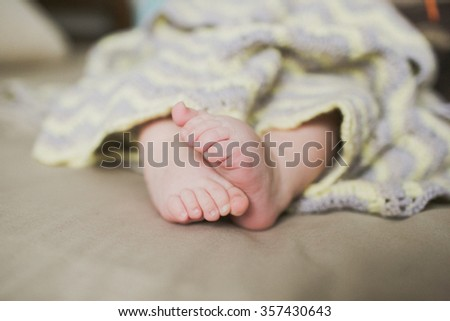 adorable newborn baby feet - stock photo