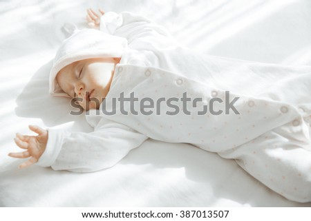 Adorable Newborn baby peacefully sleeping. Closeup Portrait. Toned in soft color. Studio shot, Horizontal - stock photo