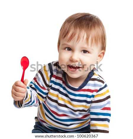 Adorable one year old child holding spoon and smiling, isolated on white - stock photo