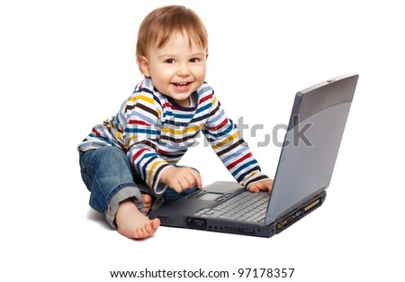 Adorable one year old child using laptop and having a great fun, isolated on white - stock photo