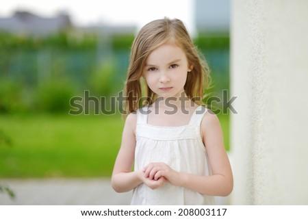 Adorable preschooler girl portrait outdoors at summer - stock photo