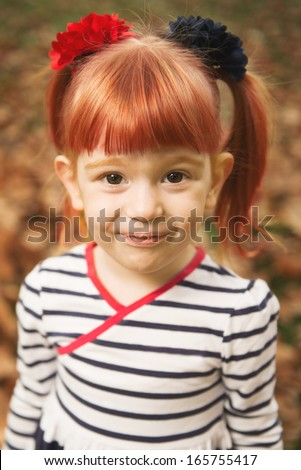 Adorable redhead little girl posing - stock photo