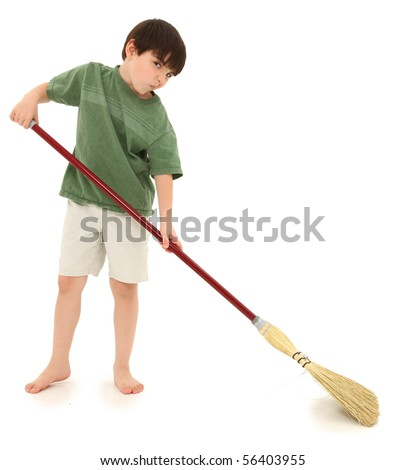Adorable seven year old french american boy sweeping over white. - stock photo