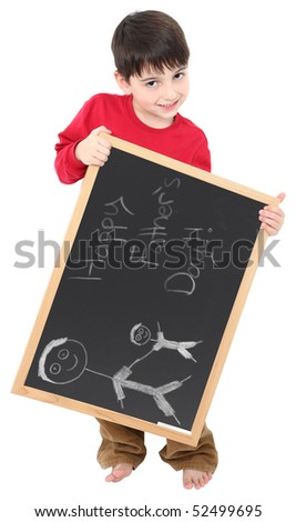 Adorable six year old boy with chalkboard displaying Happy Father's Day drawing in chalk. - stock photo