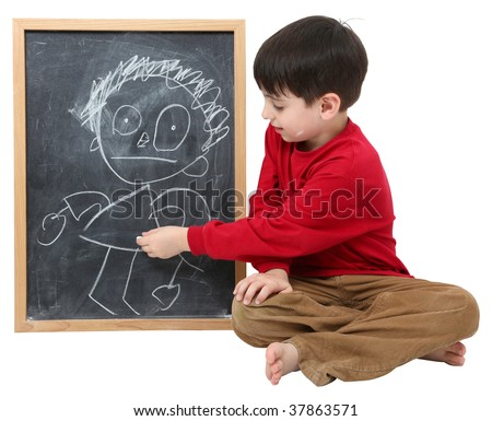 Adorable six year old school boy with drawing on chalkboard with clipping path over white. - stock photo