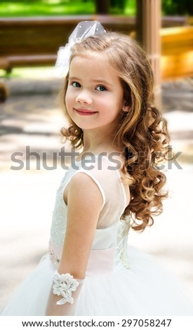 Adorable smiling little girl in princess dress outdoor - stock photo