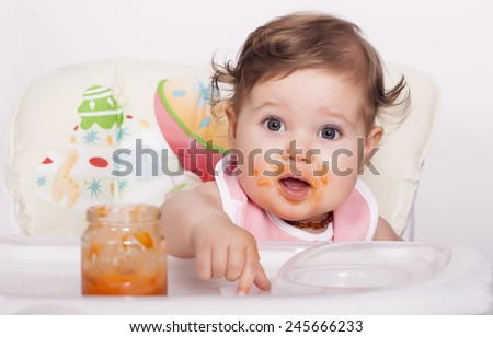 Adorable smudgy baby and favorite food - stock photo