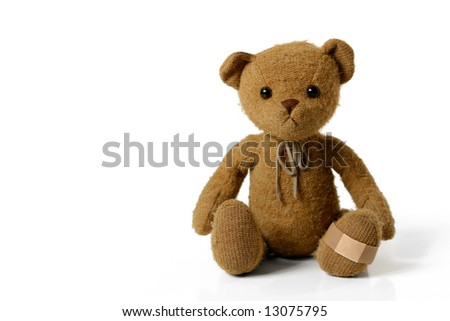 Adorable Teddy Bear with a Bandage on his Foot - stock photo
