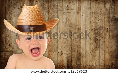 Adorable ten month old baby cowboy. - stock photo