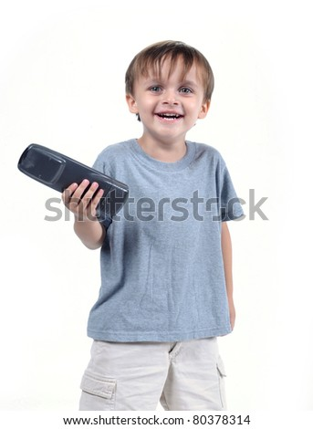 adorable 3 to 4 year old boy standing with tv remote isolated on white - stock photo