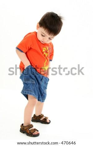 Adorable Toddler Boy Checking Pockets for Money. - stock photo