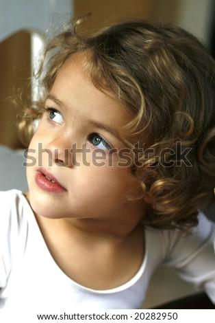 adorable toddler girl looking sideways - stock photo