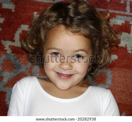 adorable toddler girl with curly hair, smiling - stock photo